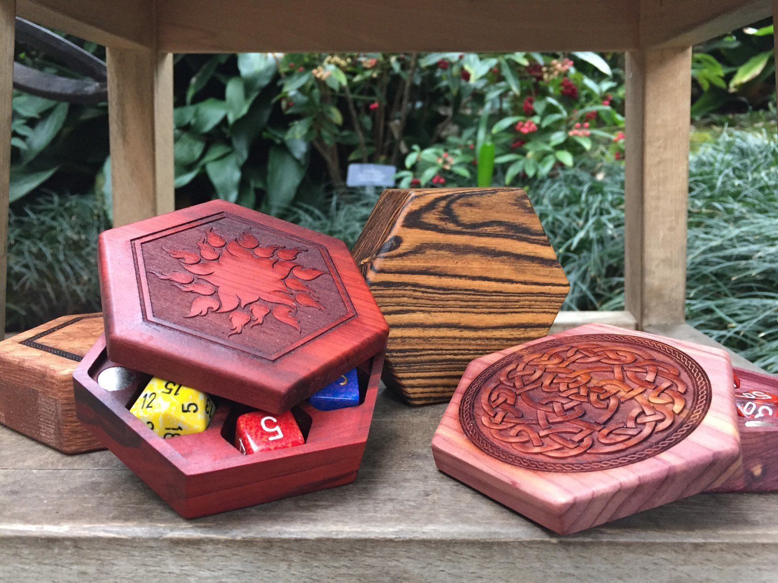 Lacewood, redheart, bocote and aromatic cedar Hex Chests (L-R)