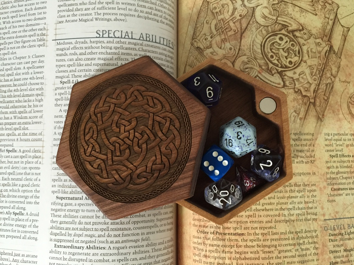 Walnut hex chest with dice and player manual