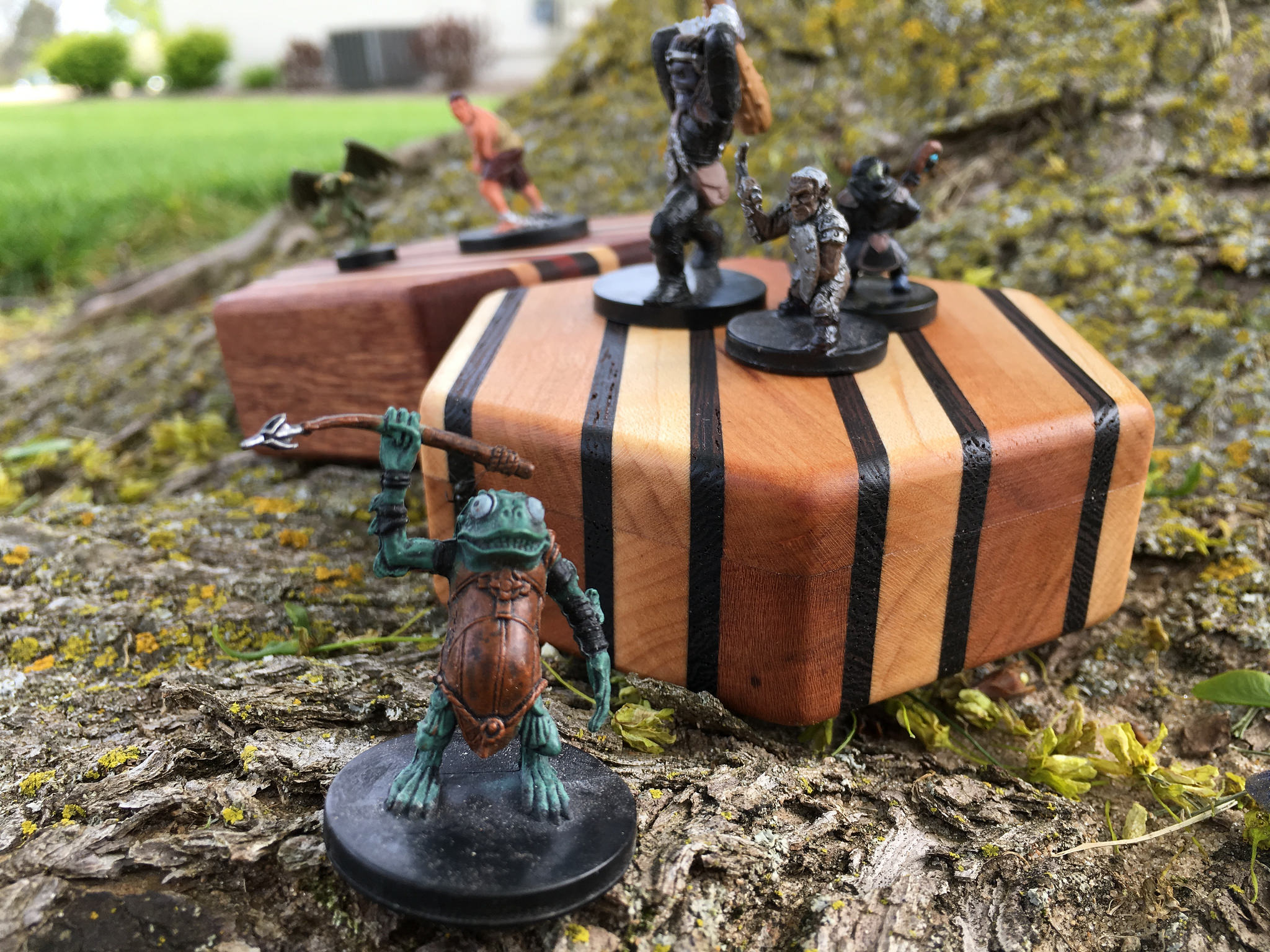 Miniatures dancing on a Hex Chest dice box
