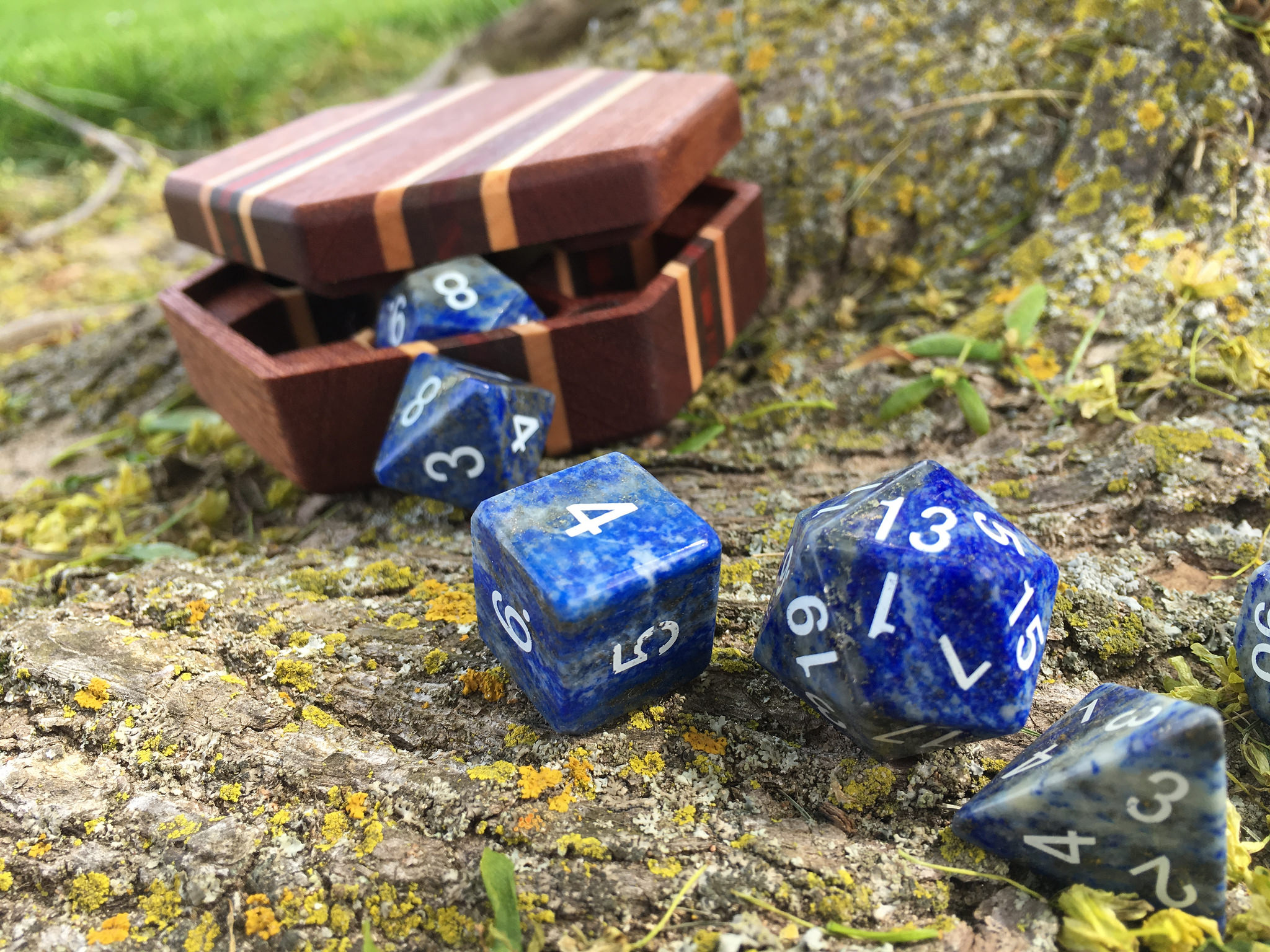 Lapis dice in front of a Hex Chest dice box