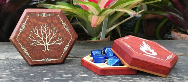 Elderwood RPG dice in a wooden dice box