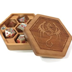 Our Hex Chest dice box in cherry hardwood with alloy metal dice