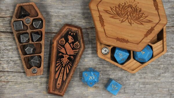 Open Mini Dice Sarcophagus with Ancient Silver Dice set next to partially open Cherry Hex Chest with Turquoise Gemstone Dice Set