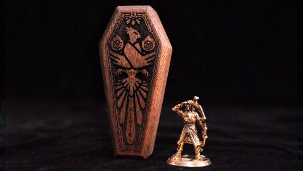 Mini Dice Sarcophagus standing up next to miniature figurine